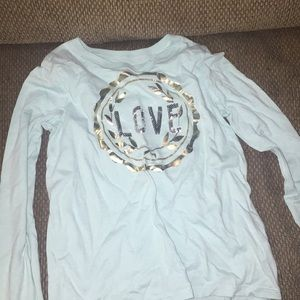 gold and blue long sleeve t-shirt